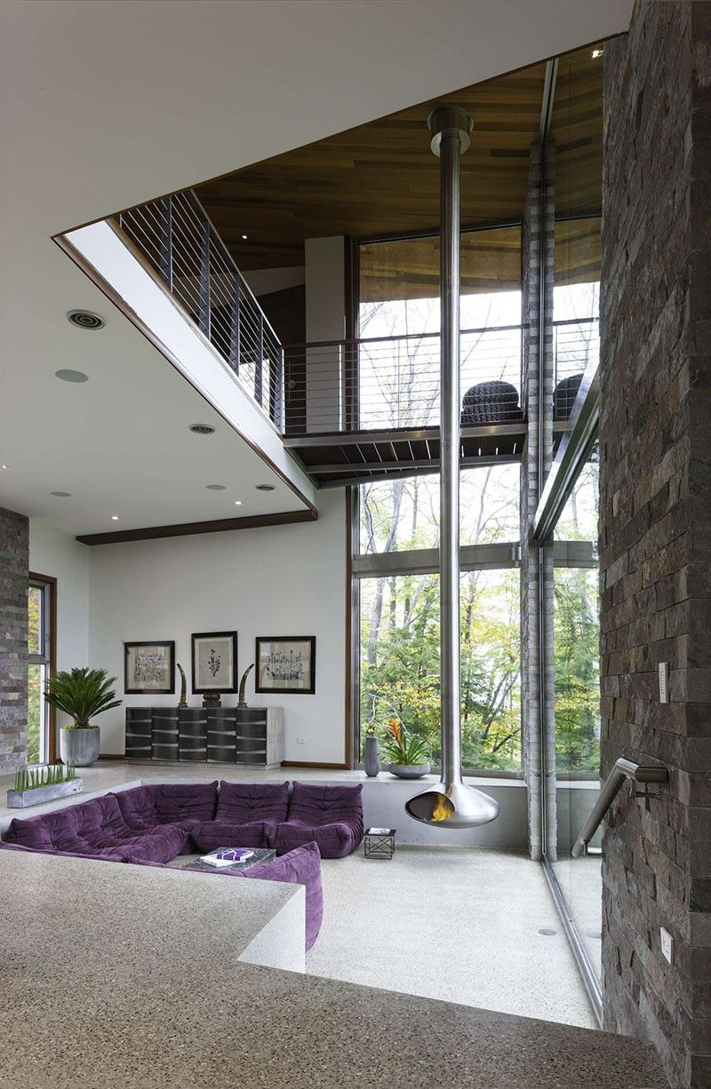 Over the years, we've seen plenty of hanging fireplaces, but this one from a house in Michigan, designed by architectMichael Fitzhugh, is possibly the longest one ever. It makes us wonder if ...